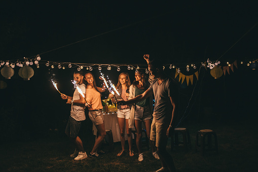 A group of youngsters is having a party outdoor