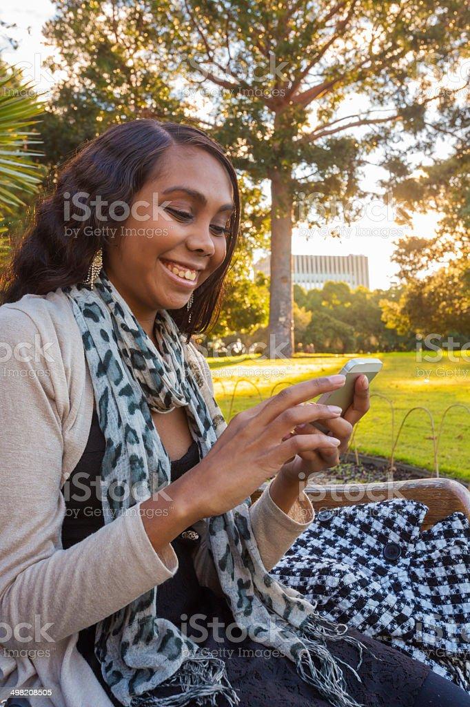Outdoor Phone Aboriginal Woman stock photo