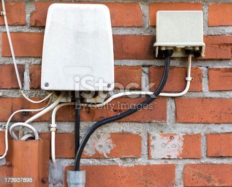 istock Outdoor phone connection wires attached to red brick wall. 173937895