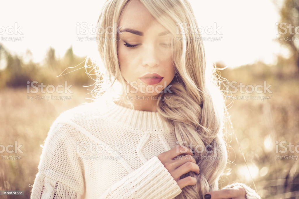 Outdoor photo of young beautiful blonde stock photo