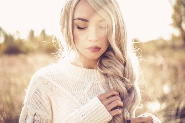 outdoor photo of young beautiful blonde - zopf frisuren stock-fotos und bilder