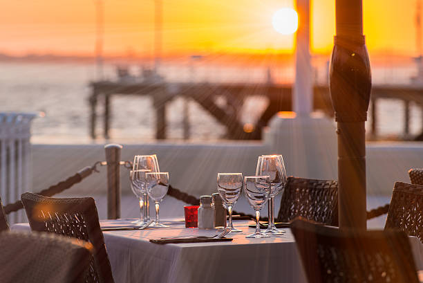 Outdoor place setting Close-up of outdoor place setting during sunset at waterfront promenade stock pictures, royalty-free photos & images