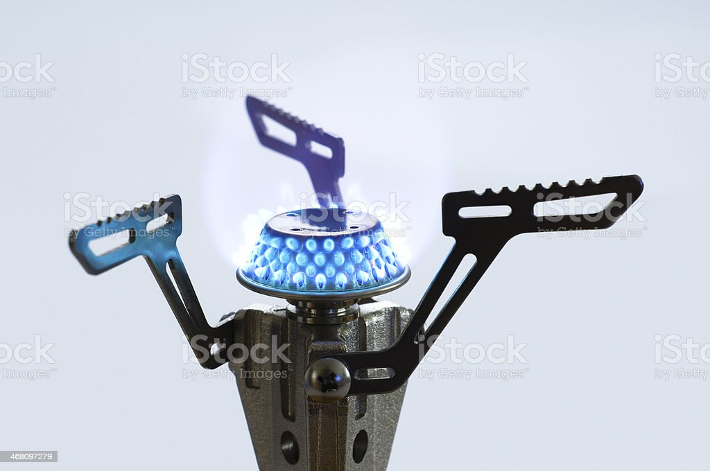 Outdoor portable stove on blue background. royalty-free stock photo