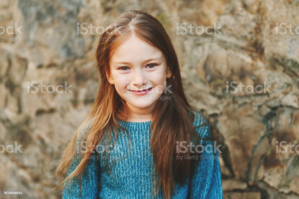 Outdoor portrait of a beautiful little girl stock photo