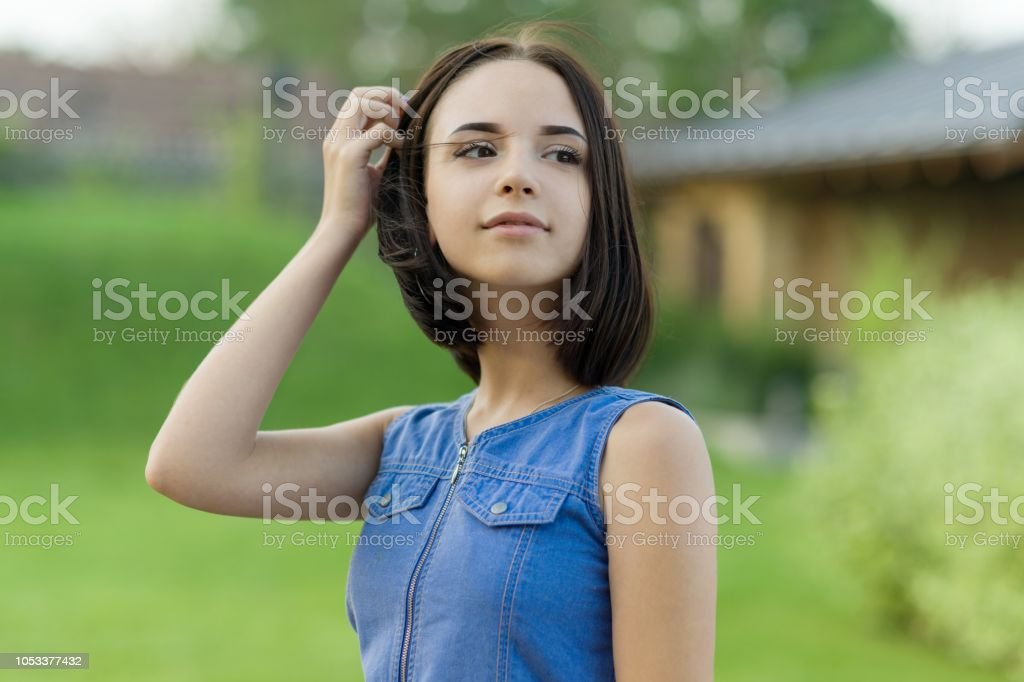 Outdoor portrait of a pretty young girl 16 years old. - foto stock