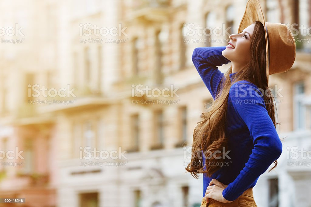 Outdoor portrait of a young beautiful happy smiling woman posing stock photo