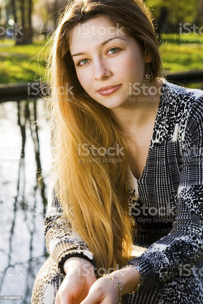 Outdoor portrait of beautiful serene young woman royalty-free stock photo
