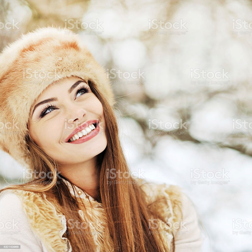 Outdoor portrait of beautiful smiling girl looking at copy space royalty-free stock photo