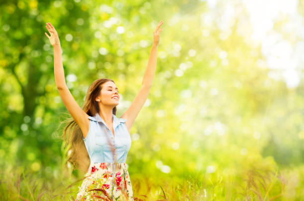 Outdoor Portrait of Beautiful Young Woman in Nature. Happy Girl Raised Arms Up in Summer Green Park stock photo
