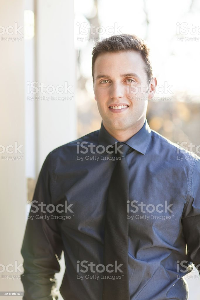 Outdoor Portrait of Caucasian Young Businessman Vertical stock photo