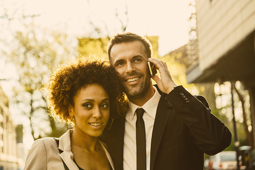 Outdoor Portrait Of Elegant Couple Man Talking On Phone Stock Photo - Download Image Now