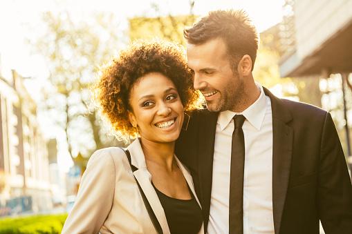Outdoor Portrait Of Flirting Elegant Couple Stock Photo - Download Image Now