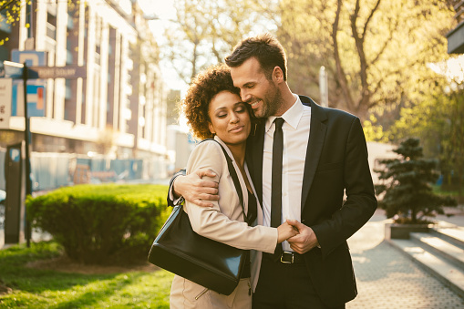 Outdoor Portrait Of Flirting Elegant Couple Stock Photo - Download Image Now
