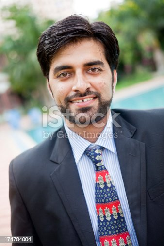 580112984 istock photo Outdoor Portrait of Handsome Asian Indian Businessman 174784004