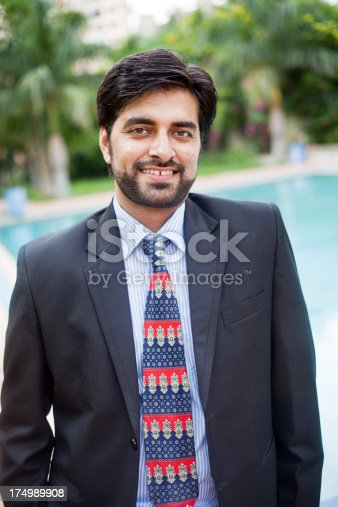 580112984 istock photo Outdoor Portrait of Handsome Asian Indian Businessman 174989908
