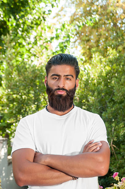 outdoor portrait of handsome asian pakistan man - styles stock photos and pictures