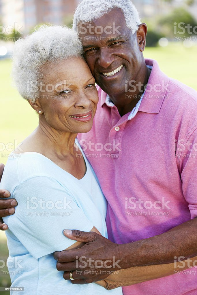 Outdoor portrait of happy elderly couple stock photo