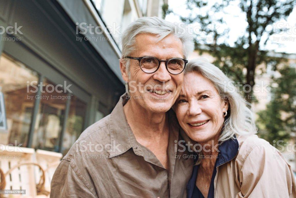 Outdoor portrait of happy senior couple stock photo