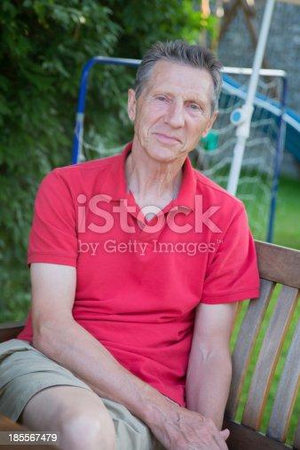 istock Outdoor Portrait Of Happy Senior Man 185567479