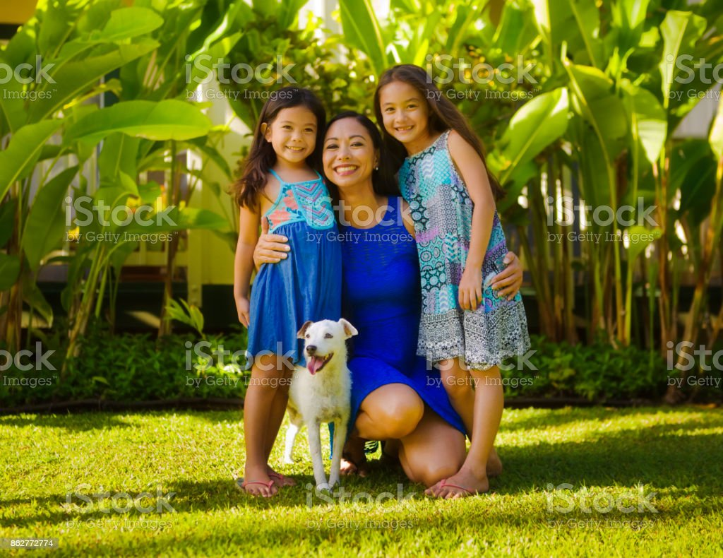 Outdoor Portrait of Hawaiian Polynesian Family with Mother, Children and pet dog stock photo
