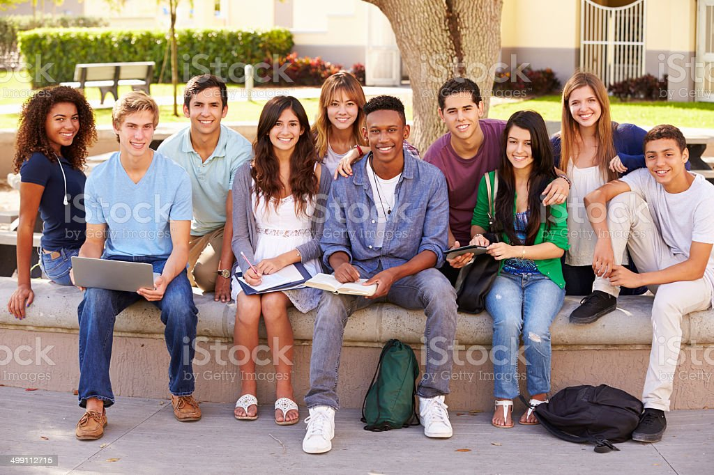 Outdoor Portrait Of High School Students On Campus stock photo