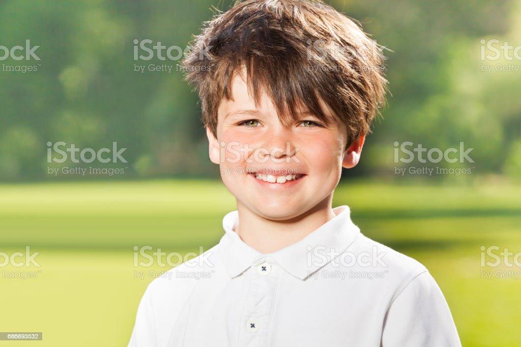 Outdoor portrait of joyful ten years old boy stock photo