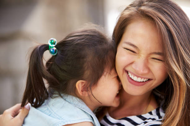 Outdoor Portrait Of Loving Mother And Daughter stock photo