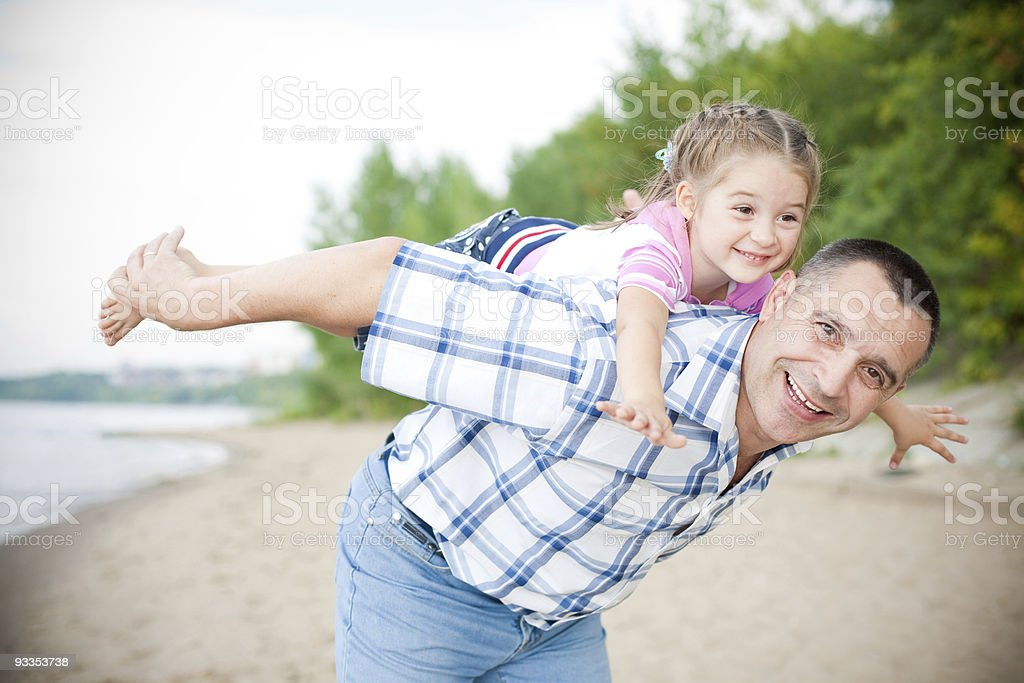 Outdoor portrait of middle-aged smiling man and his granddaughter royalty-free stock photo
