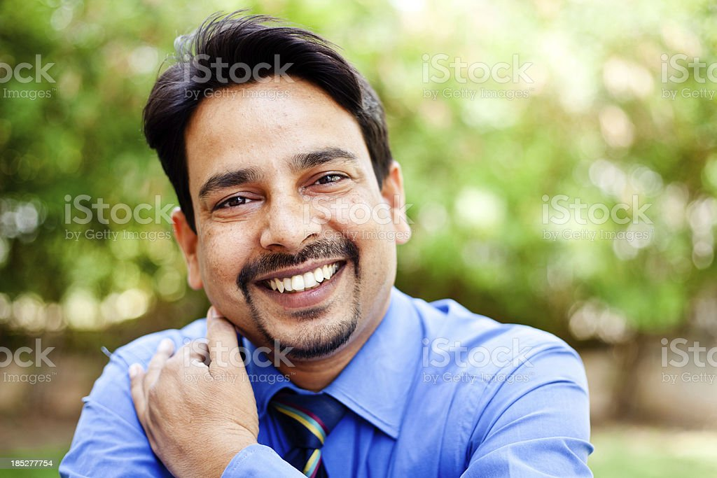 Outdoor Portrait of One Confident Cheerful Indian Businessman stock photo