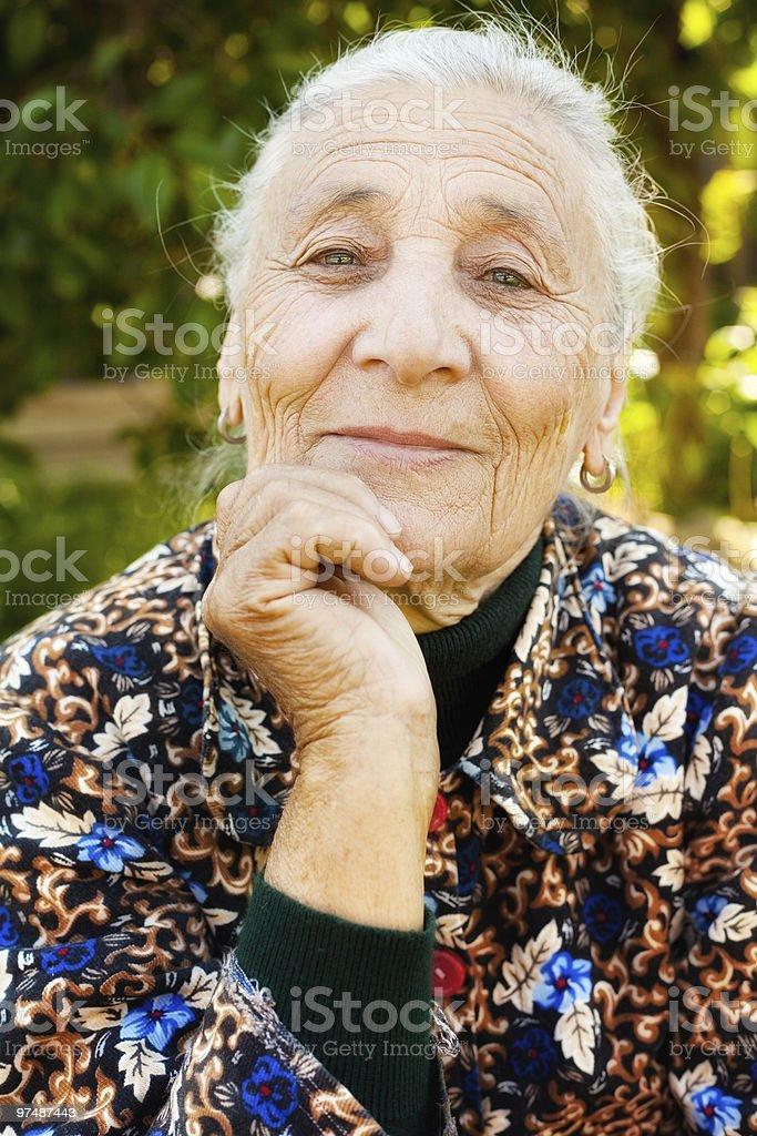 Outdoor portrait of one elegant senior woman royalty-free stock photo