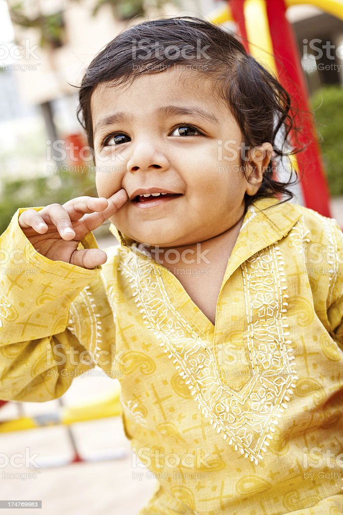 Outdoor Portrait of Small Cheerful Indian Boy Child royalty-free stock photo