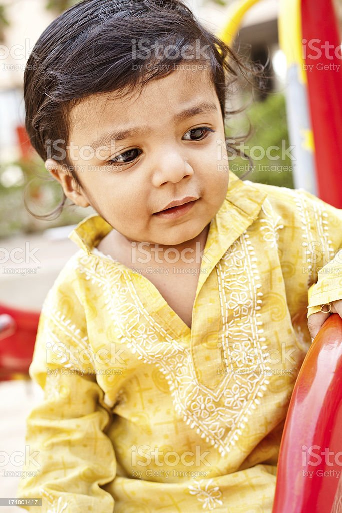 Outdoor Portrait of Small Pensive Indian Boy Child royalty-free stock photo