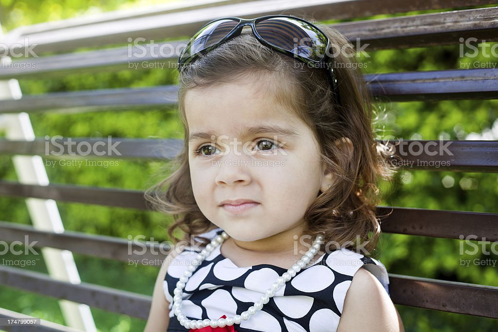Outdoor Portrait of Small Pensive Indian Girl royalty-free stock photo