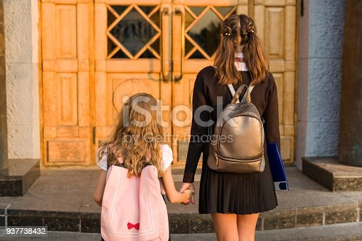 istock Outdoor portrait of two girls. 937738432