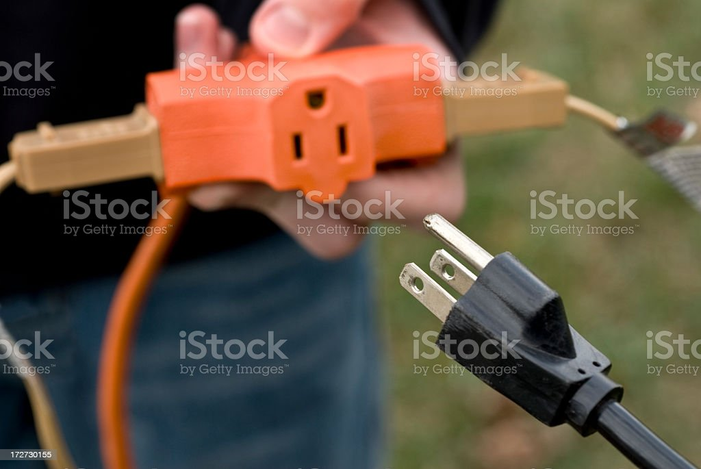 Outdoor Power Cord and 3-way Adapter royalty-free stock photo