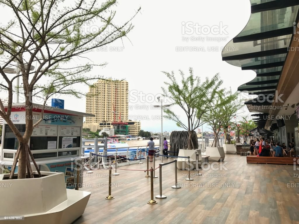 Outdoor public area near pier at River City Bangkok shopping mall where foreigners love to hang out. stock photo