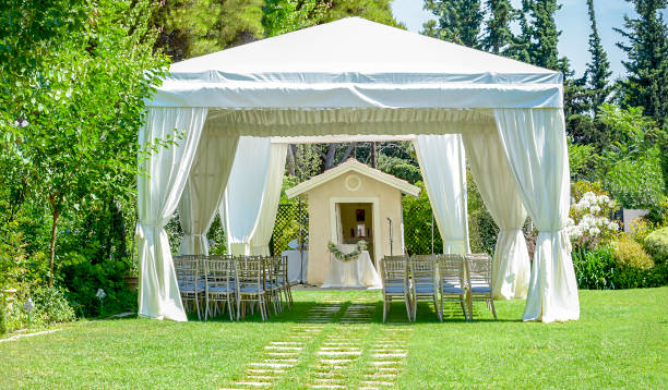 Outdoor reception under tents and trees Decorative place for ceremonies or entertainments. Outdoor reception under tents and trees tent stock pictures, royalty-free photos & images