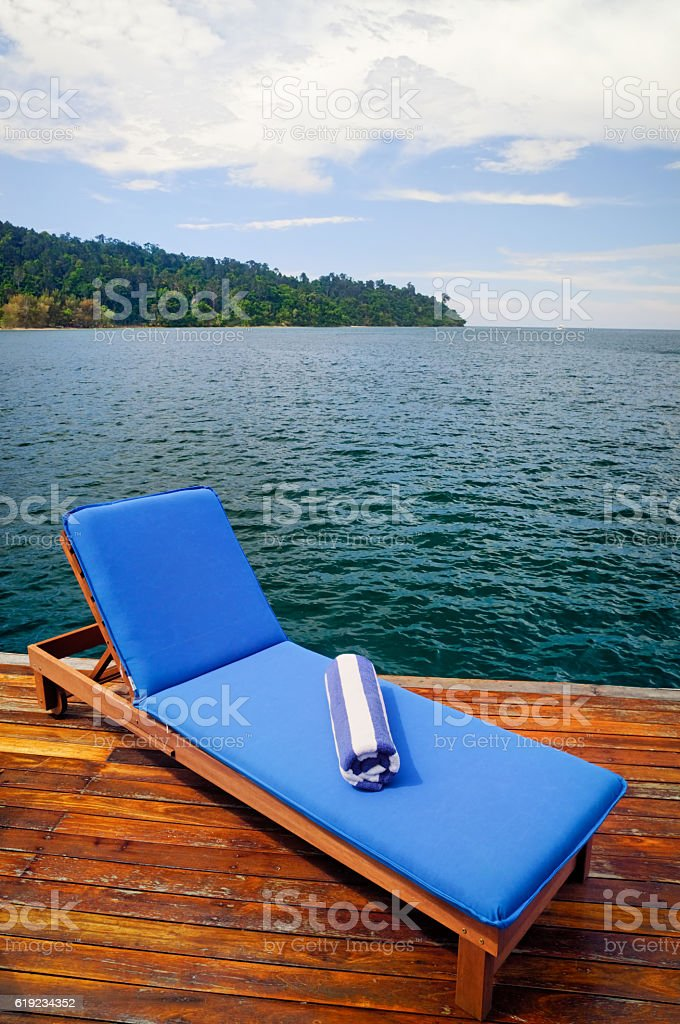 Outdoor reclining seat on deck stock photo