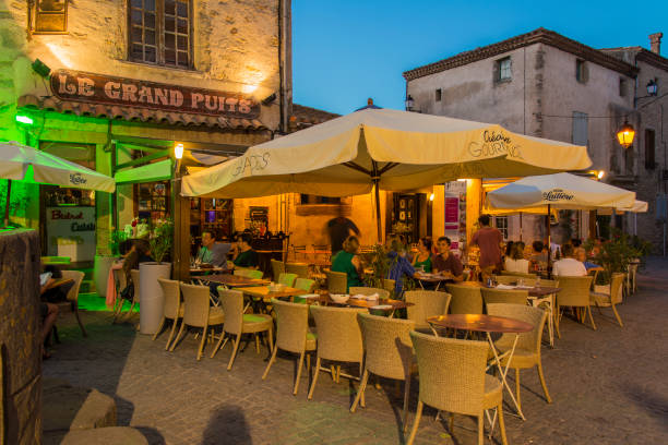 Outdoor restaurant in the old fortified citadel of Carcassonne, Languedoc-Roussillon, France stock photo