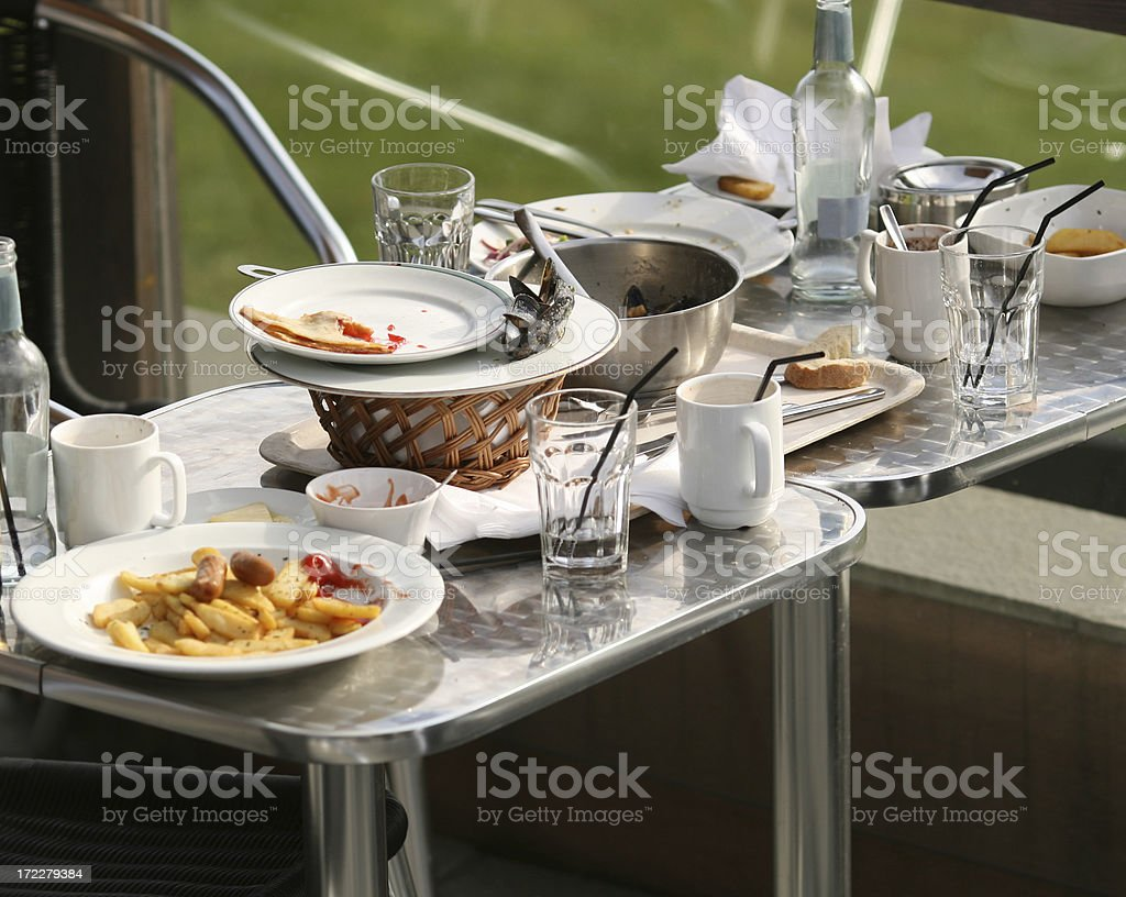Outdoor restaurant table after the guests have left stock photo