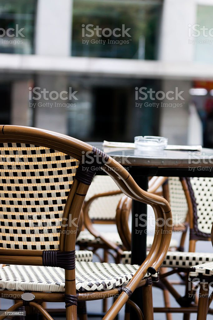 Outdoor restaurant with cane chair and table, copy space royalty-free stock photo