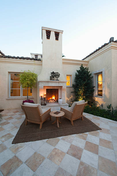 Outdoor Room At Dusk With Fireplace stock photo