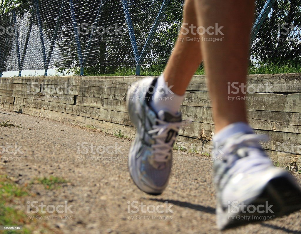 Outdoor runner with blurred feet wearing white shoes royalty-free stock photo