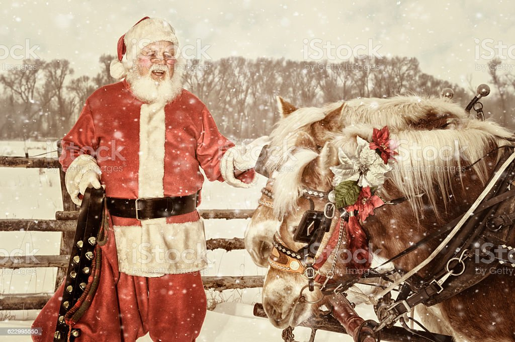 Outdoor Santa With A Team Of Horses and Hand Bells stock photo