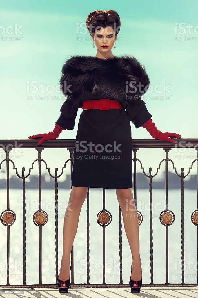 Outdoor shot of young beautiful woman wearing clothes haute couture stock photo