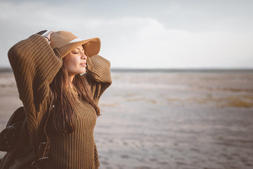 Outdoor Shot Of Young Woman Resting On The Desert Stock Photo - Download Image Now