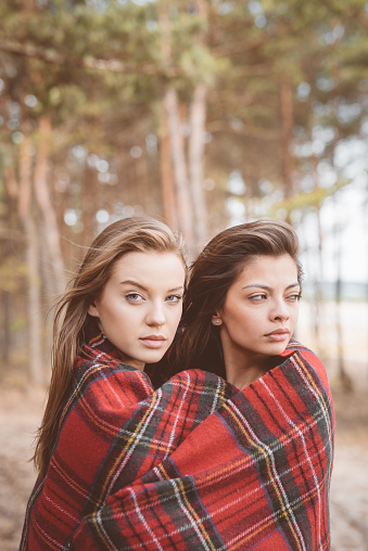 Outdoor Shot Two Female Friends In The Forest Stock Photo - Download Image Now