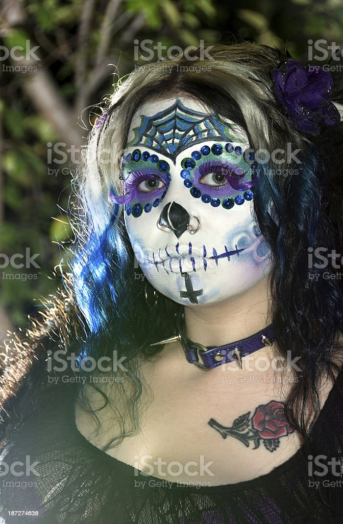 Outdoor, side lit sugar skull portrait. royalty-free stock photo