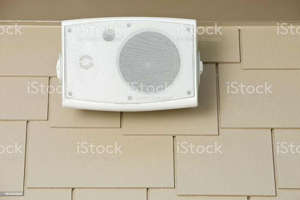 Outdoor Speaker Mounted on House Siding Below Eave royalty-free stock photo