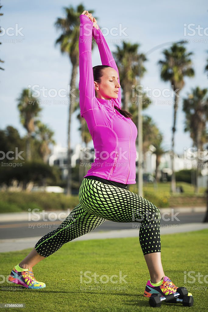 Outdoor stretching, pose 1 royalty-free stock photo
